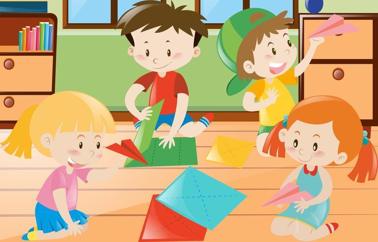 Jongens en meisjes vouwen papier in de kamer vector