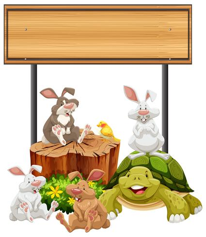 Houten bord met konijnen en schildpad vector