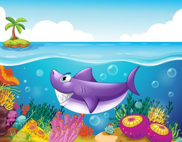 Een lachende haai onder de zee met koralen vector