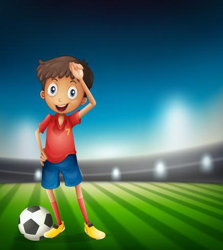 Jonge jongensvoetballer vector