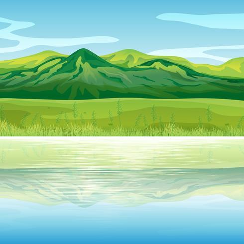 Een berg aan de overkant van het meer vector