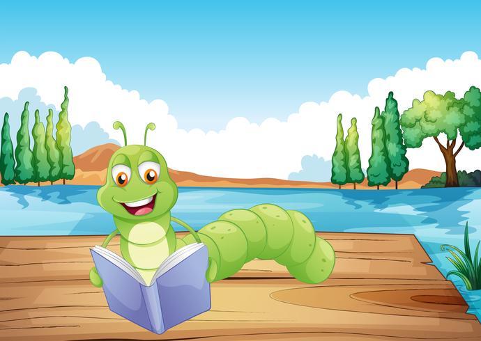 Een worm die een boek leest vector