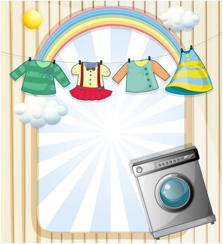 Een wasmachine met hangende kleding aan de bovenkant vector