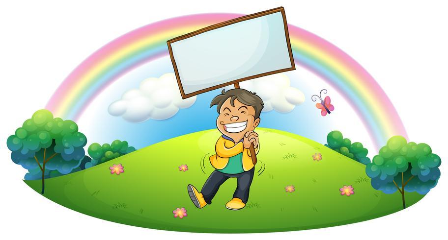 Een gelukkige jongen die een leeg uithangbord houdt vector