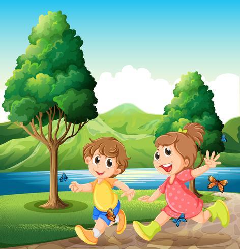 Gelukkige en energieke kinderen die dichtbij de rivier spelen vector