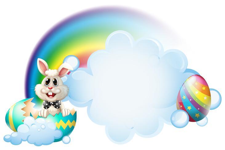Een gebarsten ei met een konijntje dichtbij de regenboog vector