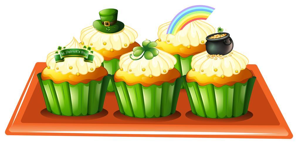 Een dienblad met vijf cupcakes vector