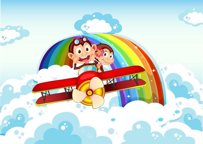 Speelse apen die op een vliegtuig dichtbij de regenboog berijden vector