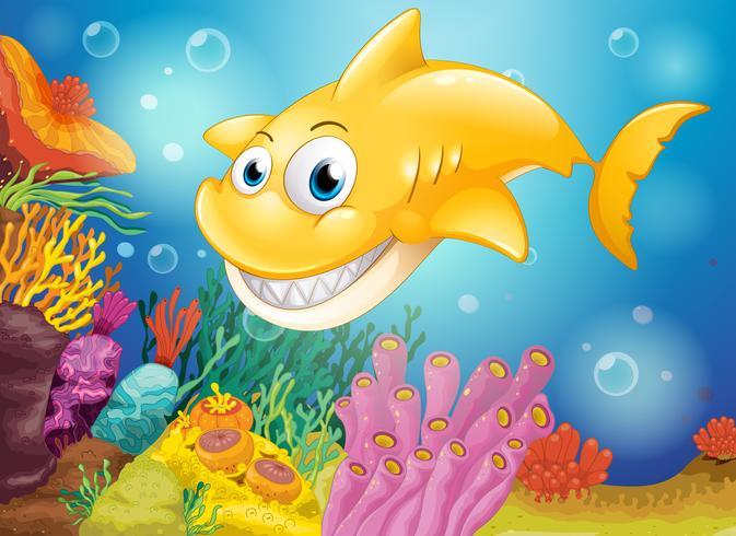 Een lachende gele haai onder de zee vector