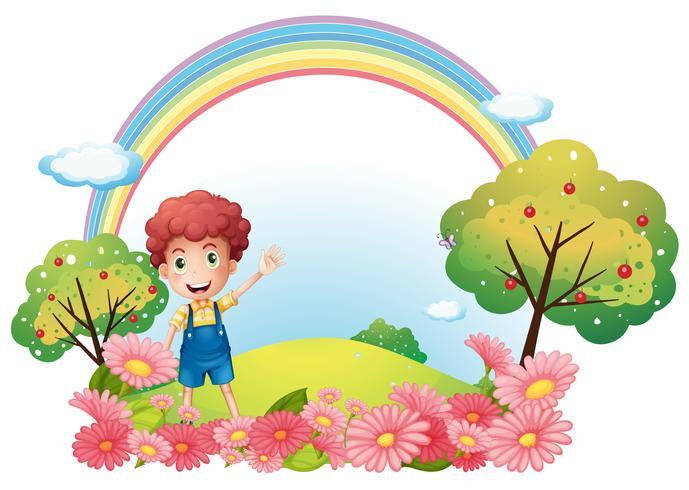 Een jongen op de heuvel met een regenboog vector