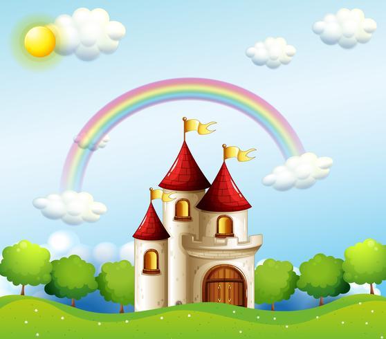 Een kasteel onder de regenboog vector
