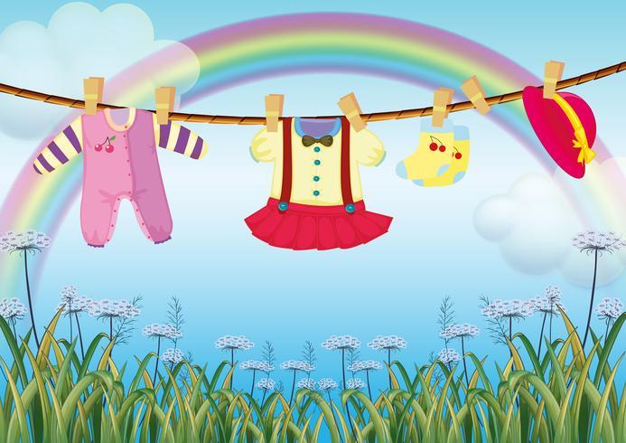 Een tuin met hangende babykleding vector
