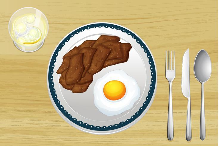 Een vlees en een omelet in een gerecht vector