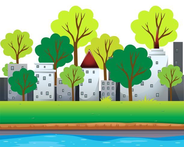 Stadsgebouwen en bomen langs de rivier vector