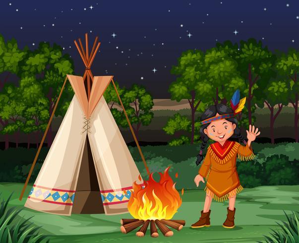 Rode indiaan bij het kampvuur vector