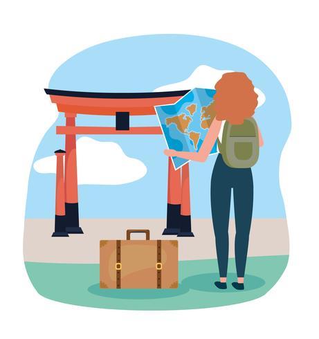 Vrouw met rugzak bij Japans oriëntatiepunt vector