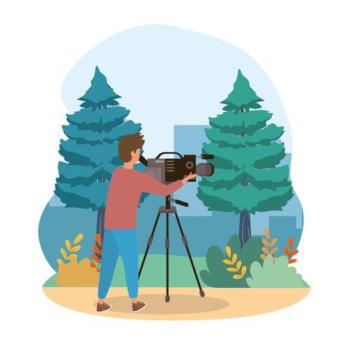 Cameraman met videoapparatuur in park vector