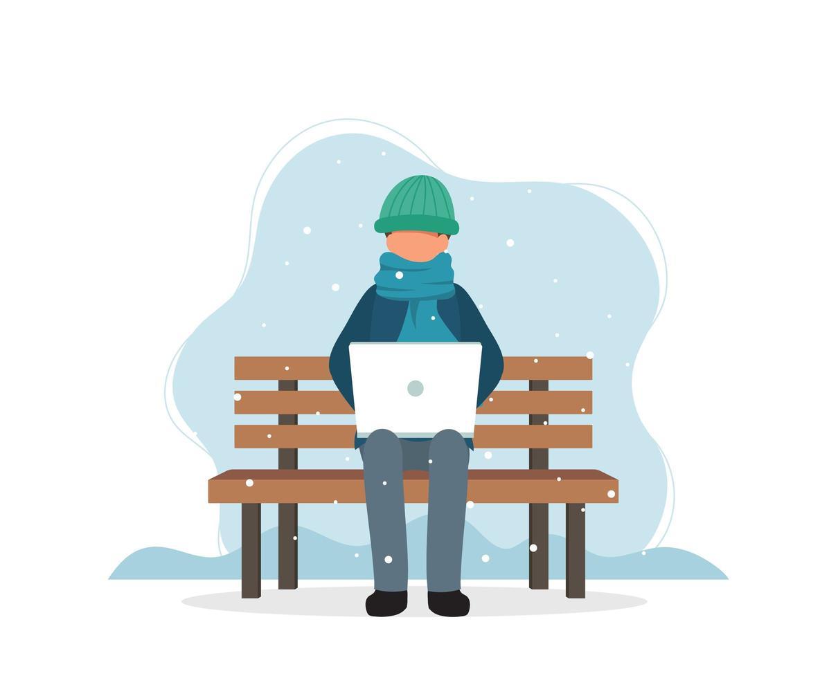 man met laptop op bankje in de winter vector
