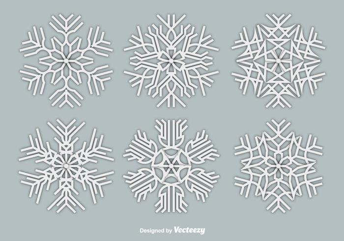 Papier witte sneeuwvlokken vector