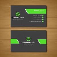 grijs visitekaartje met groene schuine vormen