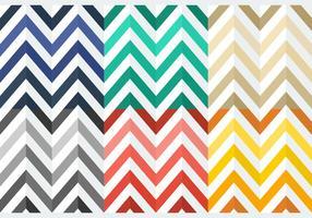 Gratis kleurrijke platte haringbonepatronen vector