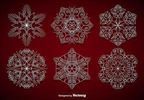 Witte elegante sneeuwvlokken vector