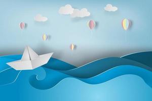 papierkunst met boot op oceaan
