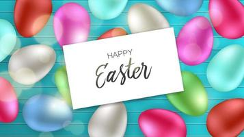 bovenaanzicht van kleurrijke eieren met happy easter kaart