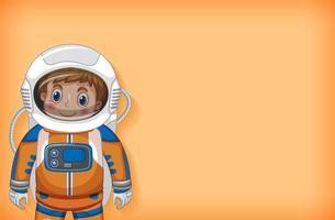 astronaut glimlachend op oranje achtergrond
