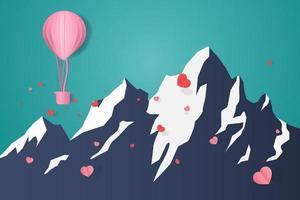 ballon drijvend op berg en verspreide papieren harten