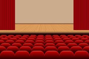 theaterzaal met rijen stoelen en podium