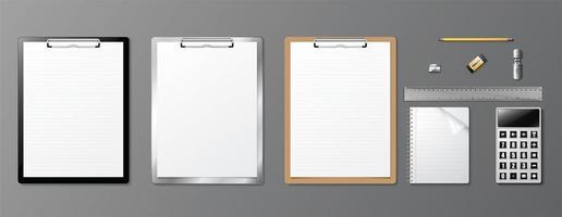 realistische kantoorbenodigdheden set met klemborden vector
