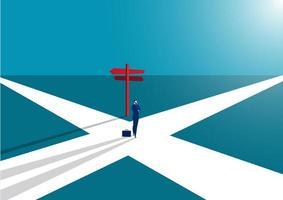 zaken man in het midden van het pad richting kiezen