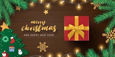 vrolijk kerstcadeau en decoraties op hout vector