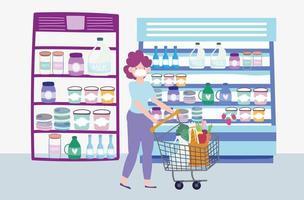 vrouw duwen een winkelwagentje bij een supermarkt