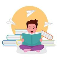 jongen zittend op boeken en lezen van een boek