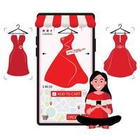 dame bestelt rode jurk online te koop via mobiele telefoon