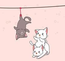 schattige witte katten spelen met hangende zwarte kat