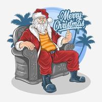Kerstman ontspannen in stoel op het strand