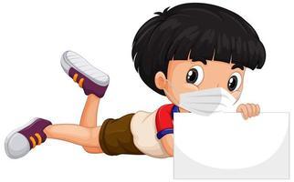jongen die met gezichtsmasker lege banner houdt