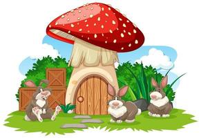 paddestoelhuis met drie konijnen