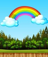 leeg landschap met grote regenboog aan de hemel