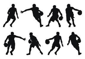 Silhouetten van de basketbalspeler vector