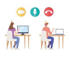 vrouw en man met feestmuts en computer