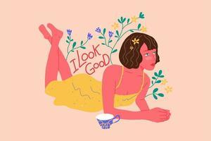 jonge vrouwen die op de vloer liggen met een positief citaat