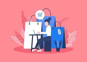 vrouw zitten met zak met goederen van online winkelen