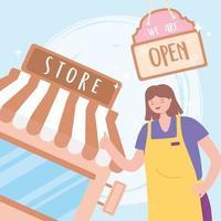 jonge vrouwelijke werknemer met schort en winkelbord