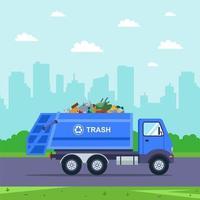 blauwe vrachtwagen haalt vuilnis de stad uit