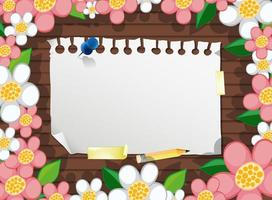bovenaanzicht van blanco papier op tafel met bloemen