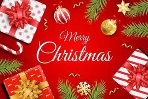 bovenaanzicht van geschenken, takken en ornamenten op rood vector